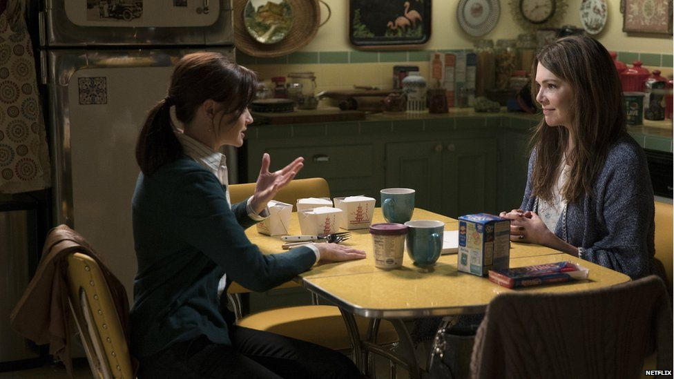 Gilmore Girls sitting at a kitchen table