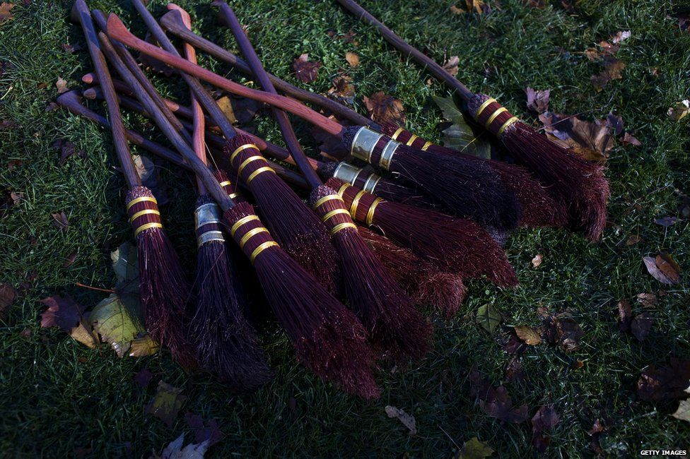 Brooms on the side of a Quidditch pitch