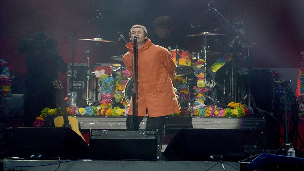 This is a photo of Liam Gallagher on stage performing at One Love Manchester