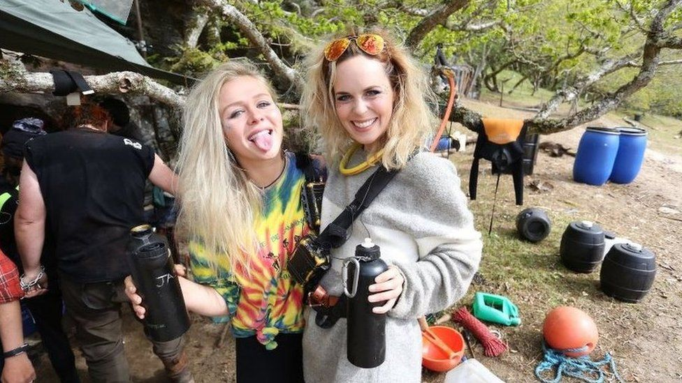 Two of the people from Eden, sticking their tongues out