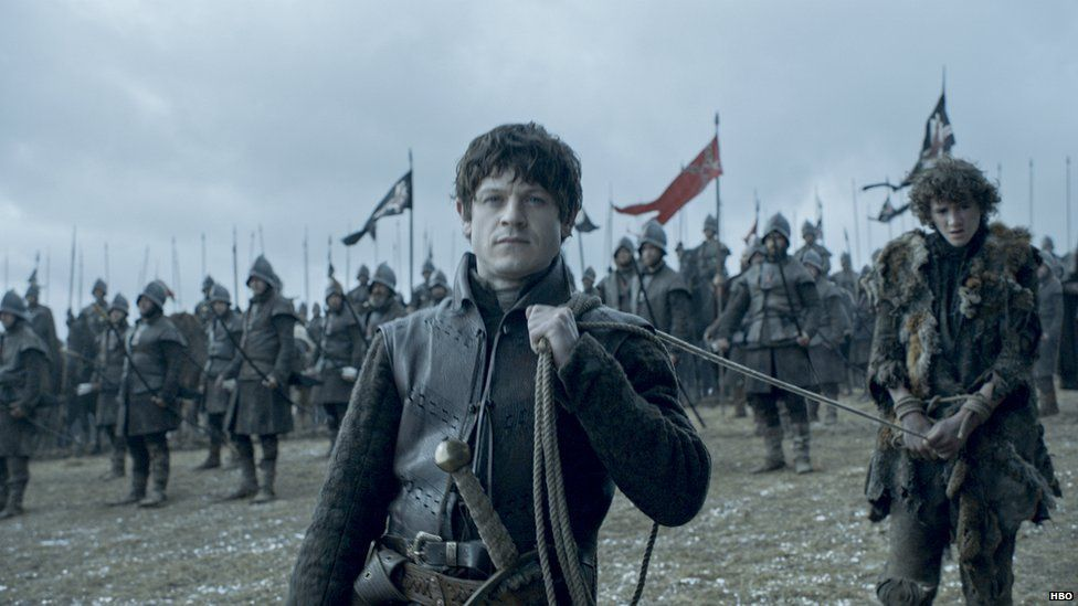 Iwan Rheon as Ramsay Bolton and Art Parkinson as Rickon Stark