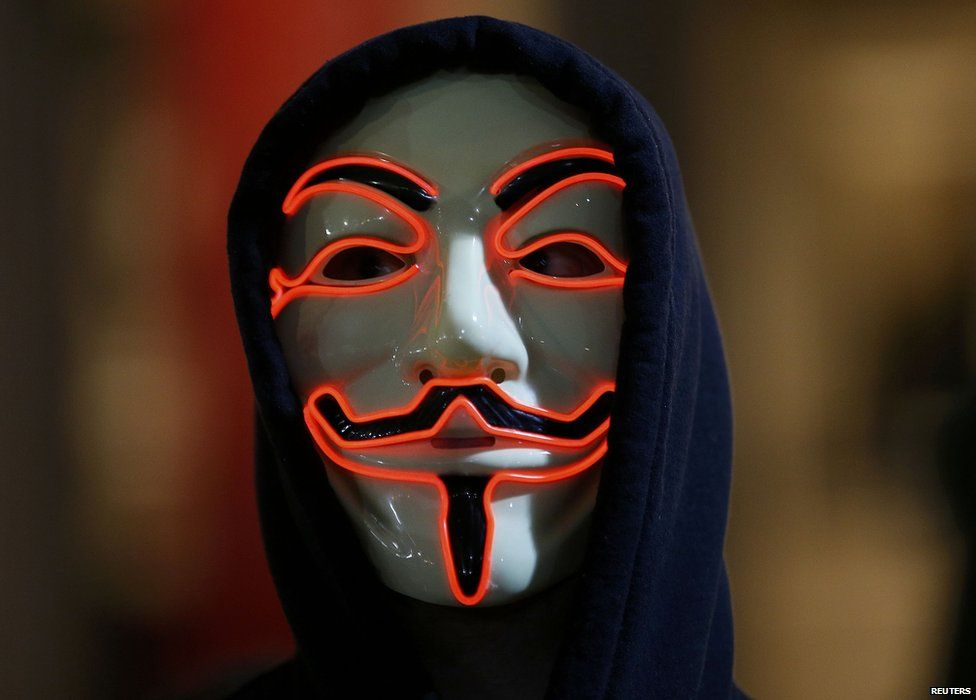 A supporter of the activist group Anonymous wears a mask during a protest in London on 5 November