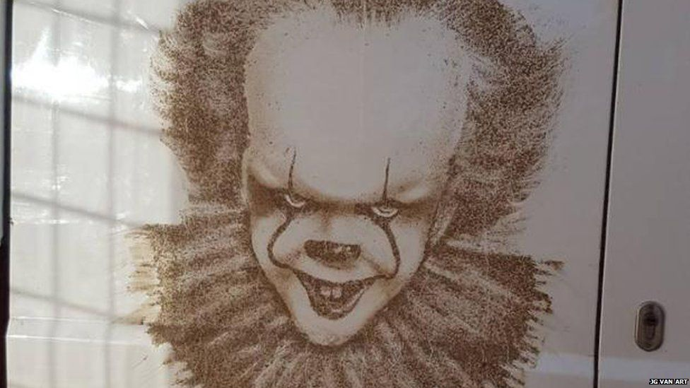 Pennywise in mud on the back of a van