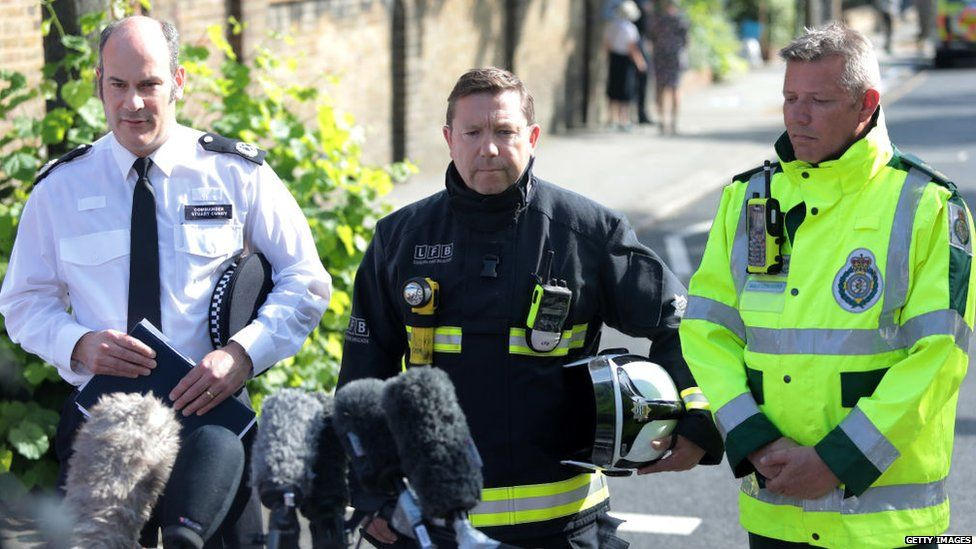 Commander Stuart Cundy of the Met Police, Steve Apter of London Fire Brigade and Paul Woodrow from the london ambulance service hold a press conference