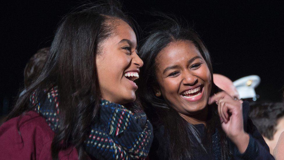 Malia And Sasha Smiling