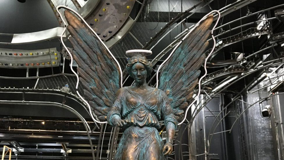 An angel with neon wings is one of the most important props