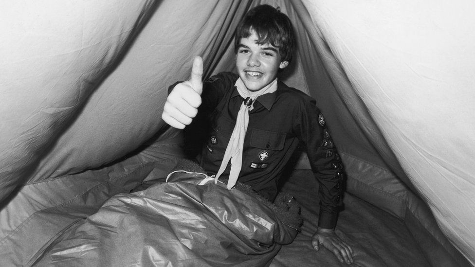 A scout in a tent in the 1980s