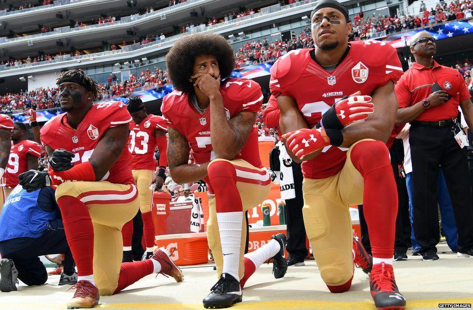 Colin Kaepernick kneeling during the American national anthem