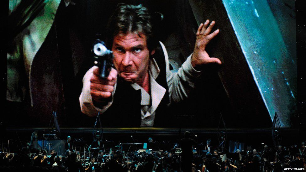 Actor Harrison Ford's Han Solo character from 'Star Wars Episode VI: Return of the Jedi' is shown on screen while musicians perform during 'Star Wars: In Concert' at the Orleans Arena May 29, 2010 in Las Vegas, Nevada