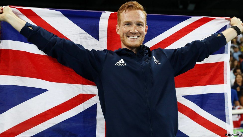 Greg Rutherford holding the Union Jack
