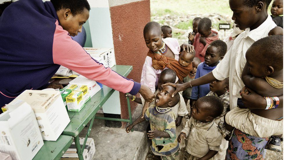 African children line up to receive medication
