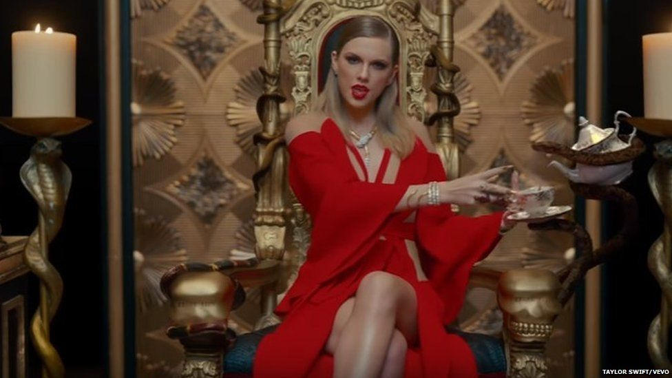 Taylor Swift on a throne
