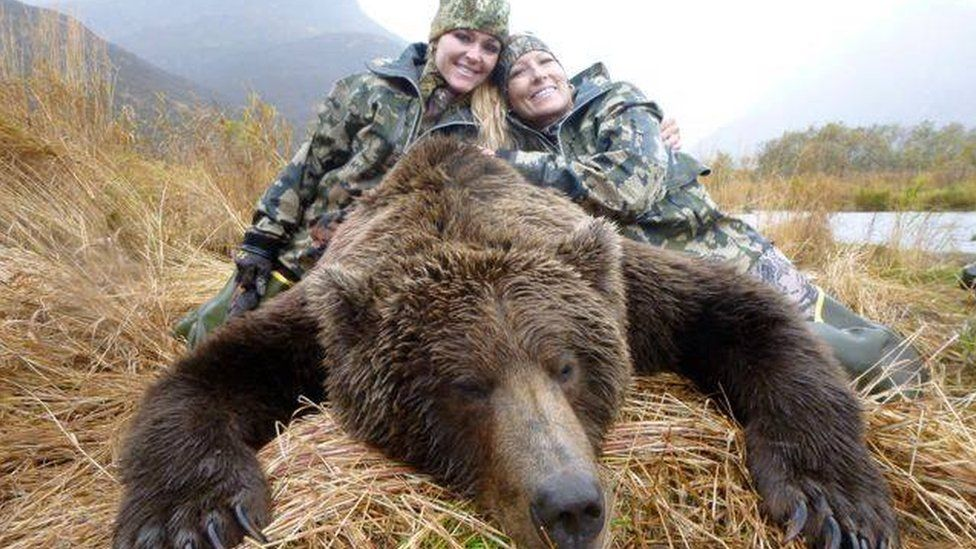 Rebecca Francis poses with a bear
