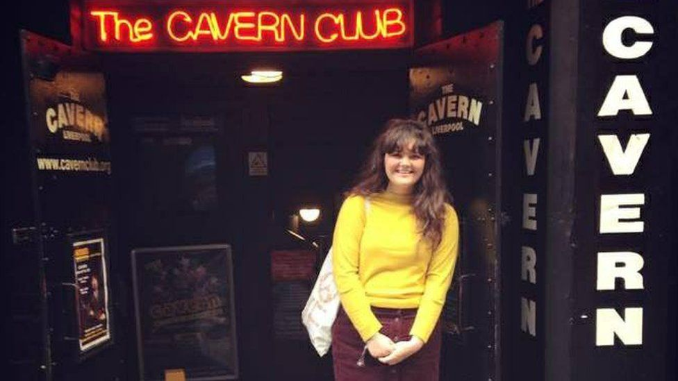 Biddy standing outside the Club where the Beatles launched their career