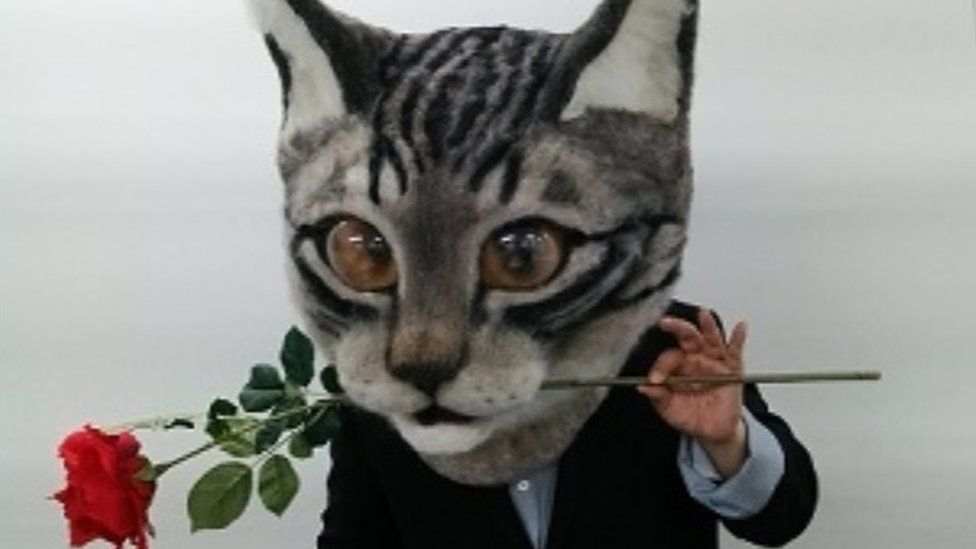 Wearing a cat head could turn you into a romantic
