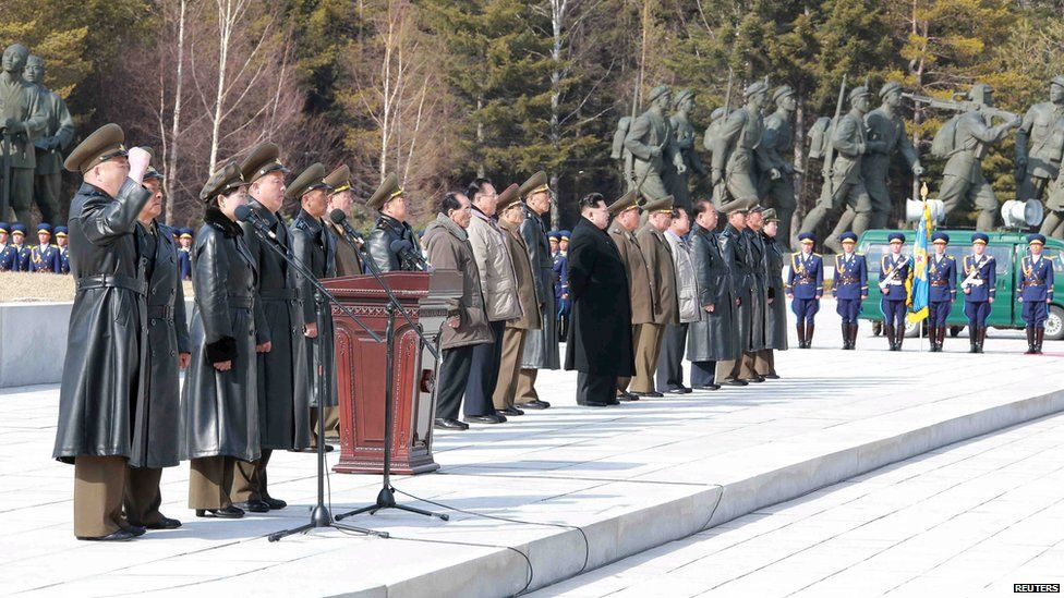 North Korean officials lined-up on a mountain