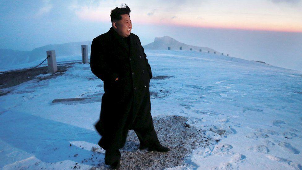 Kim Jong-Un on top of a mountain