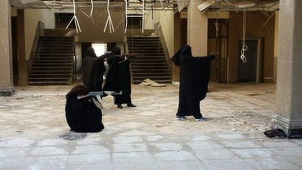 Jihadi brides posing with guns in an Islamic State propaganda picture