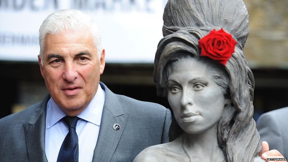 Mitch Winehouse with a statue of Amy