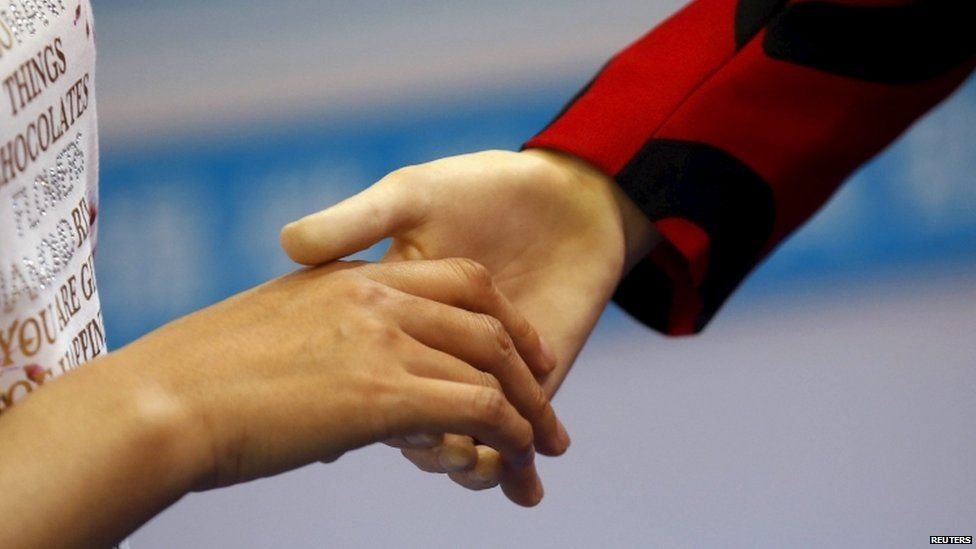 Yangyang shaking hands