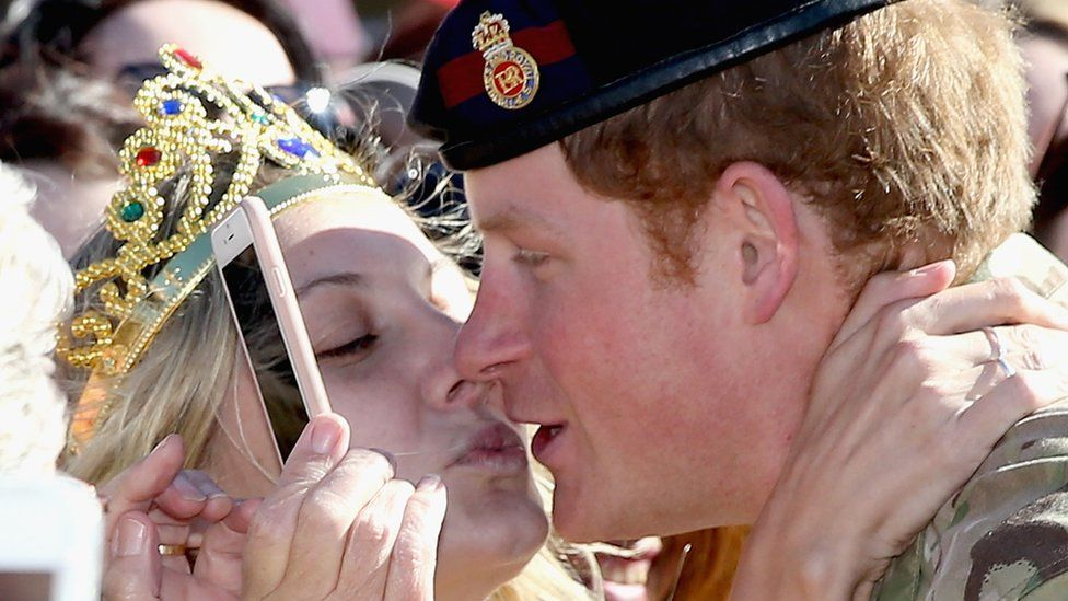 Prince Harry gets a proposal, and a kiss, outside Sydney's