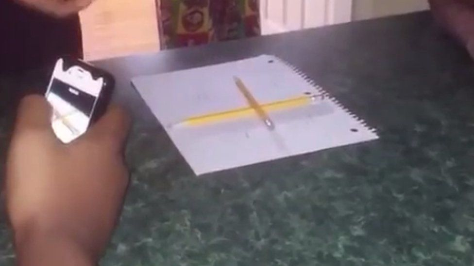 Two pencils on a piece of paper
