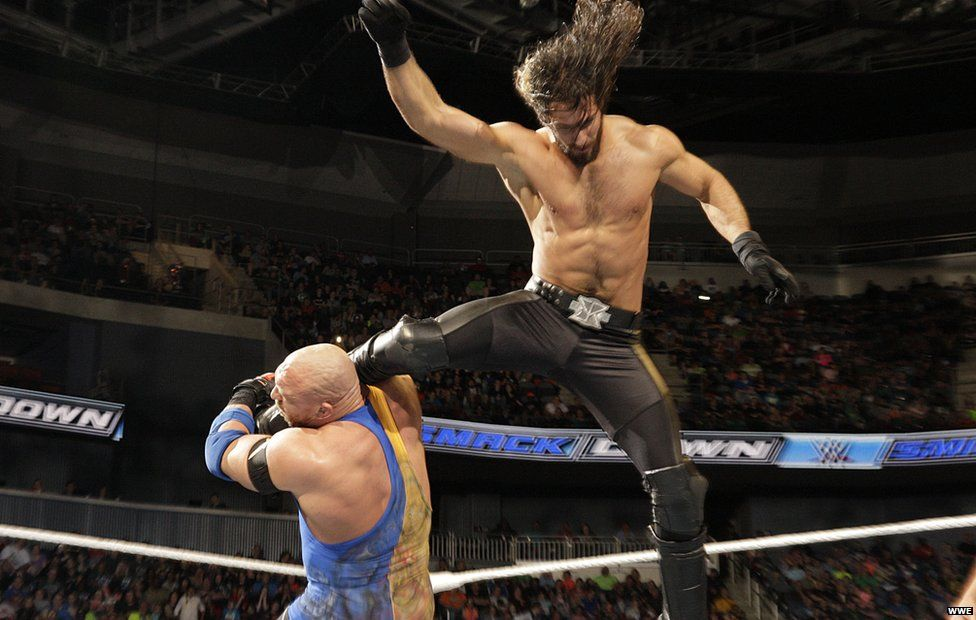Seth Rollins leaping in the ring