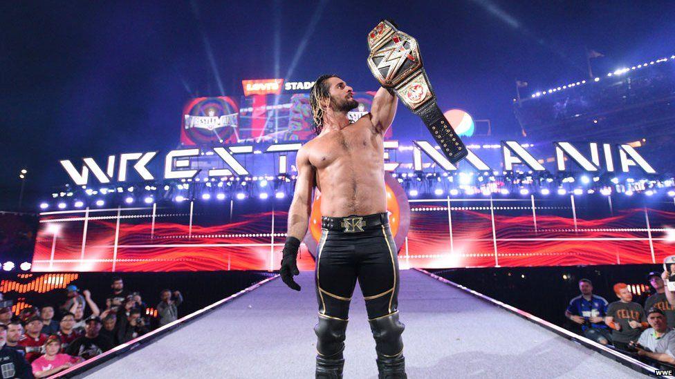 Seth Rollins holding his title belt