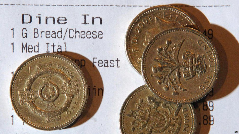 Pound coins on a receipt