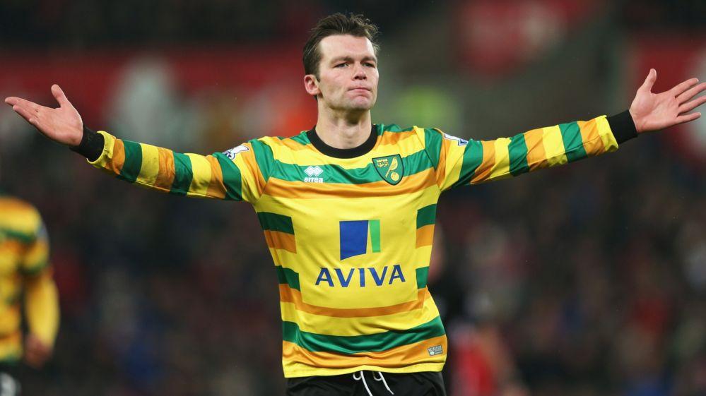 A Norwich City player celebrates scoring a goal
