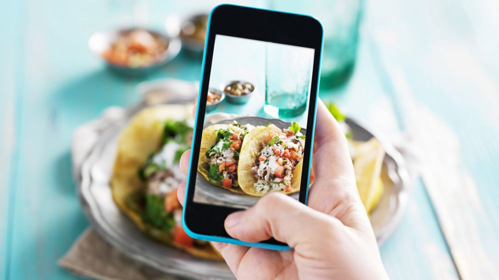 Taking a photo of tacos with a phone