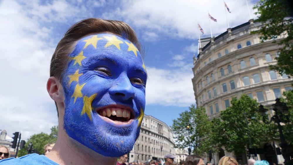 man with eu flag on face