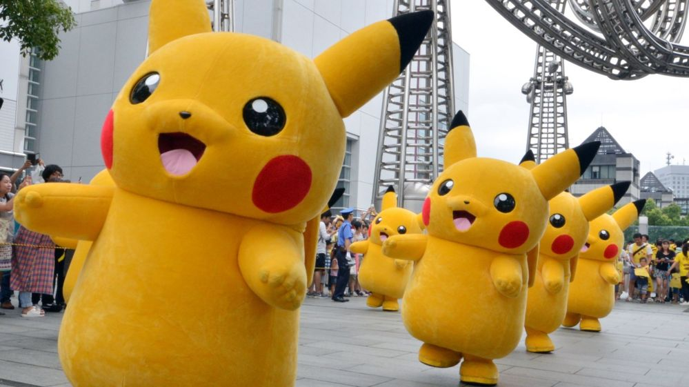 A line of Pikachu cosplayers