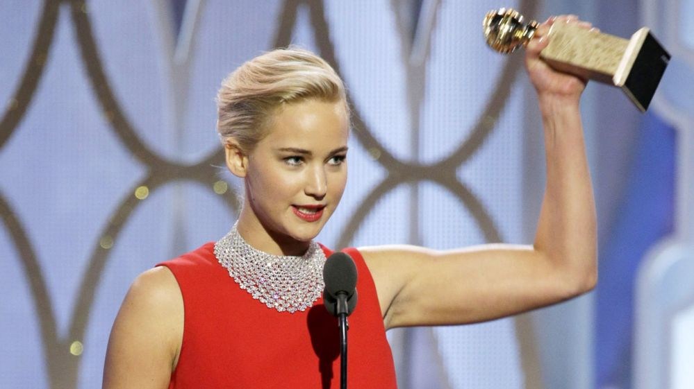 Jennifer Lawrence holds up her Golden Globe award