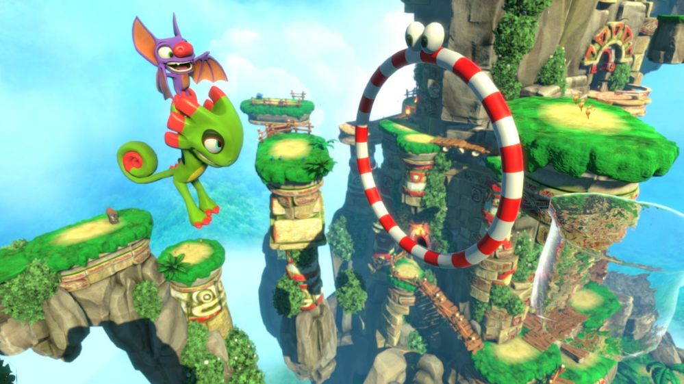 Yooka-Leylee. A dragon flies through a hoop on this platform game