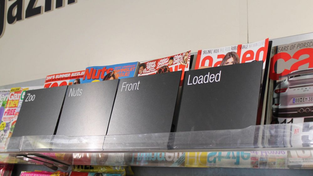 Screens covering lads' magazines in Co-Op store