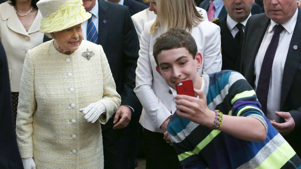 Boy takes selfie with Queen