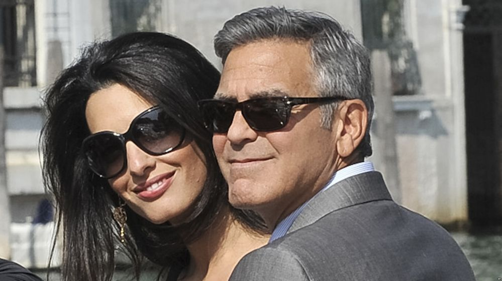 George Clooney and his fiancee Amal Alamuddin arrive in Venice