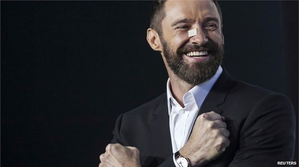 The actor smiling and wearing a plaster on his nose at the premiere of the latest X men film after treatment in May