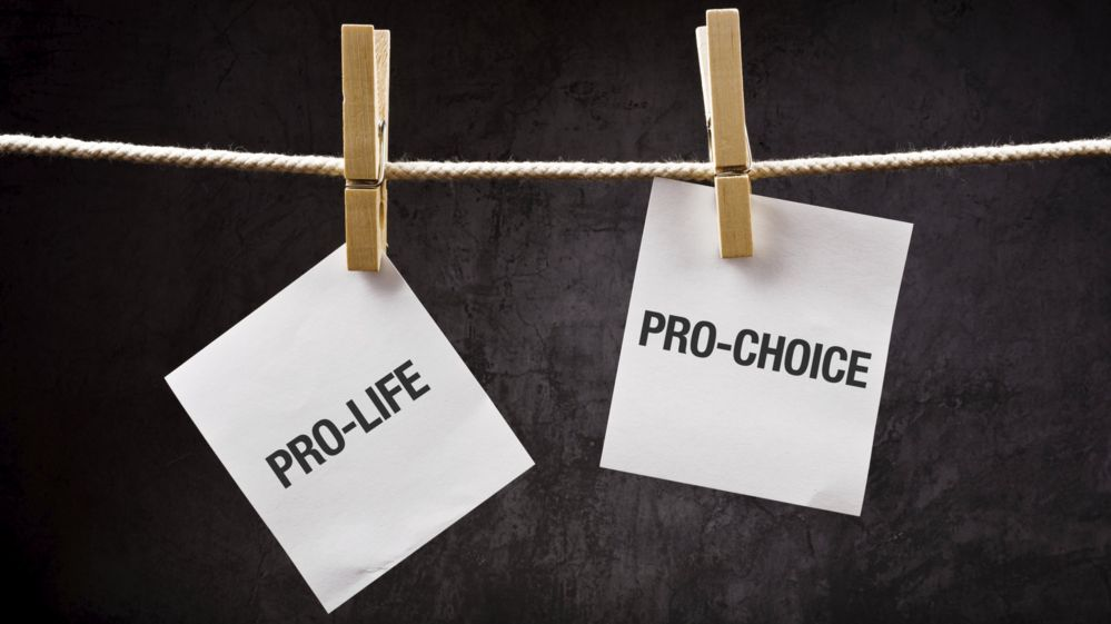 Two cards saying pro-life and pro-choice