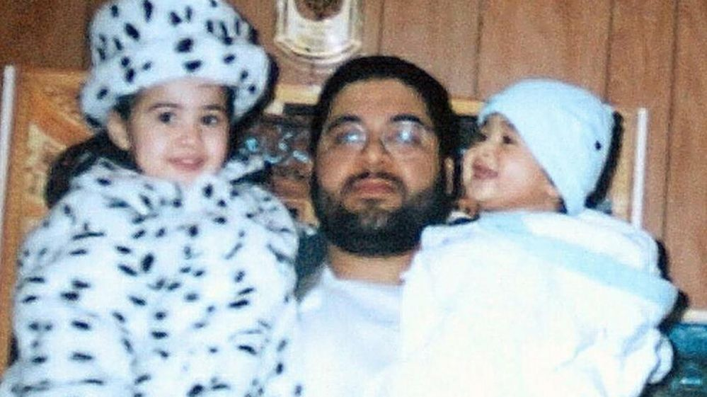 Shaker Aamer holding two of his children