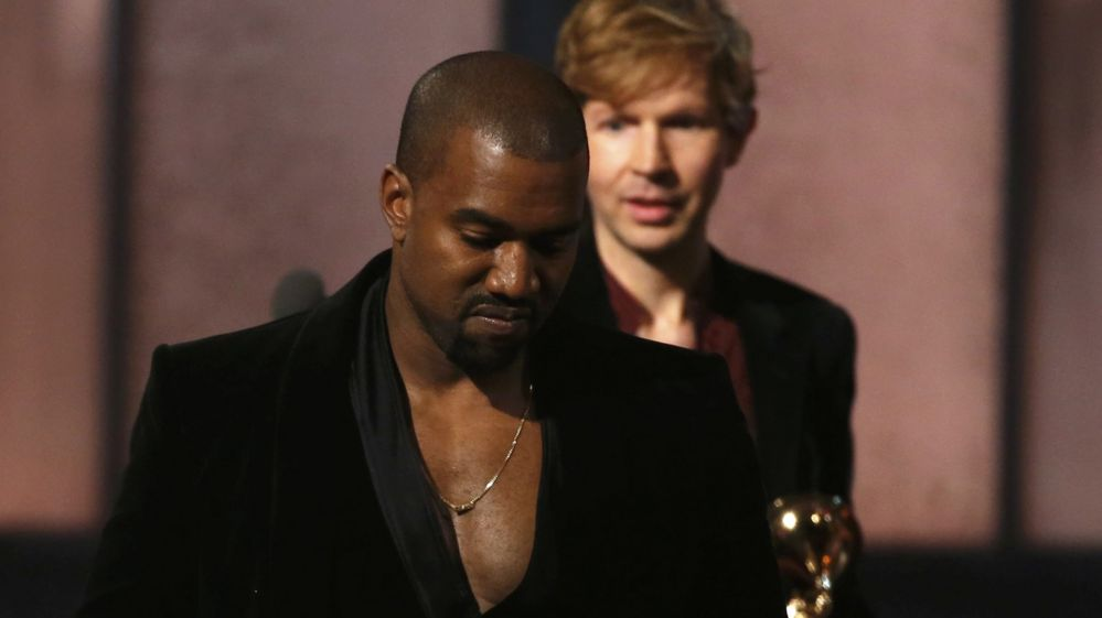 Kanye West walking away from Beck