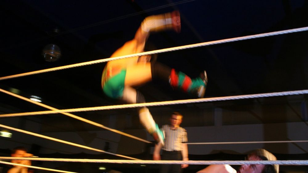 Wrestlers fight in the ring