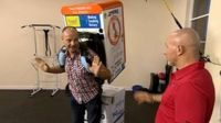 Chris Jackson tries 'The Fridge' on for size under the guidance of charity runner Tony Morrison