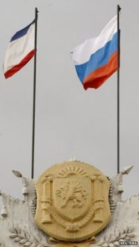 Russia's flag (R) and Crimea's regional flag on a building in Simferopol
