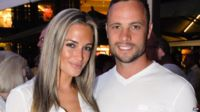 A picture taken on January 26, 2013 shows Olympian sprinter Oscar Pistorius posing next to his girlfriend Reeva Steenkamp at Melrose Arch in Johannesburg