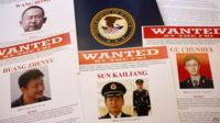 FBI (Federal Bureau of Investigation) press materials are displayed on a table of the Justice Department in Washington, 19 May 2014