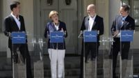"Dutch Prime Minister Mark Rutte (L), Swedish Prime Minister Fredrik Reinfeldt (2nd R) and British Prime Minister David Cameron (R) listen as German Chancellor Angela Merkel speaks during a joint news conference at Reinfeldt""s summer residence in Harpsund, south of Stockholm June 10, 2014."