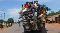 Men on a vehicle approaching an anti-balaka militia checkpoint on 2 March 2014 in Bangui
