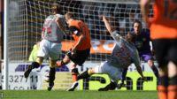 Chris Erskine scores for Dundee United against St Mirren
